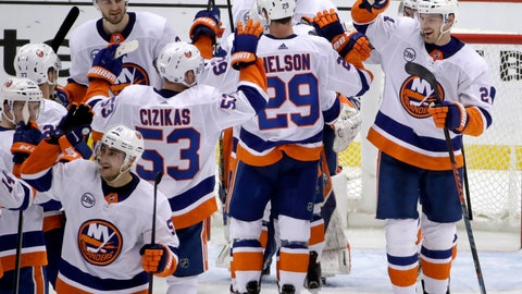 <p>               New York Islanders celebrate at the end of Game 4 of an NHL hockey first-round playoff series against the Pittsburgh Penguins in Pittsburgh, Tuesday, April 16, 2019. The Islanders won 3-1, and swept the series. (AP Photo/Gene J. Puskar)             </p>
