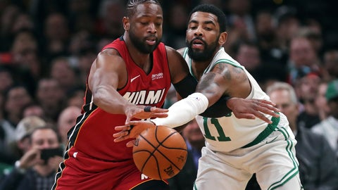<p>               Boston Celtics guard Kyrie Irving (11) reaches in on a steal-attempt against Miami Heat guard Dwyane Wade (3) during the first quarter of an NBA basketball game in Boston, Monday, April 1, 2019. (AP Photo/Charles Krupa)             </p>