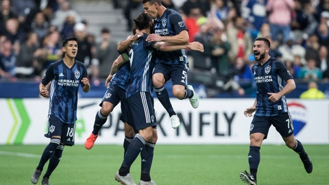 <p>               LA Galaxy's Uriel Antuna, Jonathan dos Santos, back, Zlatan Ibrahimovic, Daniel Steres and Romain Alessandrini, from left, celebrate Ibrahimovic's goal against the Vancouver Whitecaps during the second half of an MLS soccer match Friday, April 5, 2019, in Vancouver, British Columbia. (Darryl Dyck/The Canadian Press via AP)             </p>