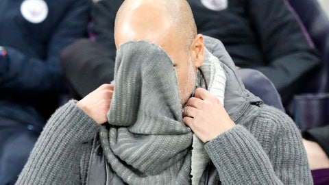 <p>               Manchester City coach Pep Guardiola fixes his sweater during the Champions League, round of 8, first-leg soccer match between Tottenham Hotspur and Manchester City at the Tottenham Hotspur stadium in London, Tuesday, April 9, 2019. (AP Photo/Frank Augstein)             </p>