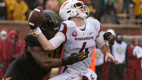 <p>               FILE - In this Nov. 23, 2018, file photo, Missouri defensive lineman Jordan Elliott, left, hits Arkansas quarterback Ty Storey, right, causing him to fumble the ball, during the first half of an NCAA college football game in Columbia, Mo. Elliott is expected to emerge as one of Missouri's top defensive players in 2019. (AP Photo/L.G. Patterson, File)             </p>
