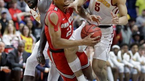 <p>               Ohio State's Musa Jallow (2) collides with Iowa State's Marial Shayok, left, and Lindell Wigginton (5) during the second half of a first round men's college basketball game in the NCAA Tournament Friday, March 22, 2019, in Tulsa, Okla. Ohio State won 62-59. (AP Photo/Jeff Roberson)             </p>