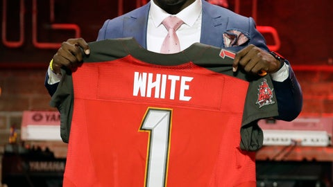 <p>               Louisiana State linebacker Devin White poses with his new jersey after the Tampa Bay Buccaneers selected White in the first round at the NFL football draft, Thursday, April 25, 2019, in Nashville, Tenn.(AP Photo/Steve Helber)             </p>