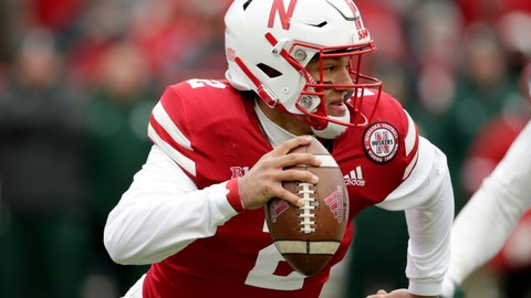 <p>               FILE -  In this file Nov. 17 2018, photo, Nebraska quarterback Adrian Martinez scrambles away from a Michigan State defender during an NCAA college football game in Lincoln, Neb. Martinez exceeded the hype that followed him from Fresno, Calif., to Lincoln as coach Scott Frost's first recruit. He was the first true freshman quarterback to start a season opener for the Cornhuskers and became the most productive rookie in program history. (AP Photo/Nati Harnik)             </p>