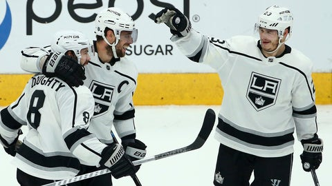 <p>               Los Angeles Kings defenseman Drew Doughty (8) celebrates his empty-net goal against the Arizona Coyotes with Kings center Anze Kopitar, middle, and right wing Dustin Brown (23) during the third period of an NHL hockey game, Tuesday, April 2, 2019, in Glendale, Ariz. The Kings defeated the Coyotes 3-1. (AP Photo/Ross D. Franklin)             </p>