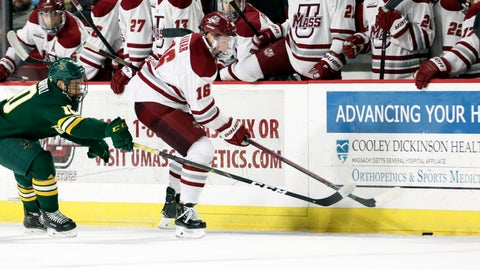 <p>               FILE - In this  Saturday, Jan. 12, 2019 file photo, UMass Amherst defenseman Cale Makar (16) reaches for the puck with Vermont forward Vlad Dzhioshvili (10) close behind during a NCAA hockey game in Amherst, Mass. Defenseman Cale Makar cited loyalty in sticking to his commitment to play at Massachusetts despite a coaching change. Two years later, Makar is a Hobey Baker finalist and has the Minutemen (30-9) preparing to make their first Frozen Four appearance. UMass will face Denver, while Providence is playing Minnesota Duluth in the semifinals on Thursday, April 11, 2019.(AP Photo/Scott Eisen, File)             </p>