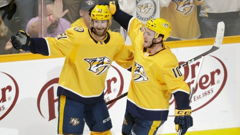 <p>               Nashville Predators center Colton Sissons (10) celebrates with Austin Watson (51) after Sissons scored against the Chicago Blackhawks during the third period of an NHL hockey game Saturday, April 6, 2019, in Nashville, Tenn. The Predators won 5-2. The win gave the Predators first place in the Central Division for the Stanley Cup playoffs. (AP Photo/Mark Humphrey)             </p>
