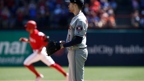 <p>               Houston Astros starting pitcher Collin McHugh looks towards the outfield as Texas Rangers' Hunter Pence (24) rounds the bases after hitting a home run during the third inning of a baseball game Sunday, April 21, 2019, in Arlington, Texas. (AP Photo/Mike Stone)             </p>