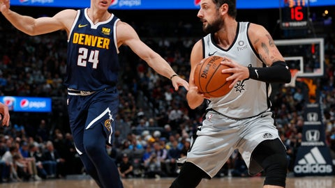 <p>               San Antonio Spurs guard Marco Belinelli, right, goes up for a basket as Denver Nuggets forward Mason Plumlee defends in the first half of an NBA basketball game Wednesday, April 3, 2019, in Denver. (AP Photo/David Zalubowski)             </p>
