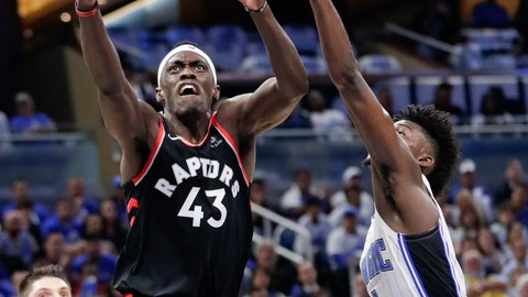 <p>               Toronto Raptors' Pascal Siakam (43) shoots against Orlando Magic's Nikola Vucevic (9) and Jonathan Isaac, right, during the first half in Game 3 of a first-round NBA basketball playoff series, Friday, April 19, 2019, in Orlando, Fla. (AP Photo/John Raoux)             </p>