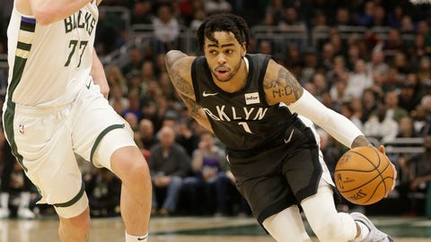 <p>               Brooklyn Nets' D'Angelo Russell, right, drives against the Milwaukee Bucks' Ersan Ilyasova, left, during the second half of an NBA basketball game Saturday, April 6, 2019, in Milwaukee. (AP Photo/Jeffrey Phelps)             </p>