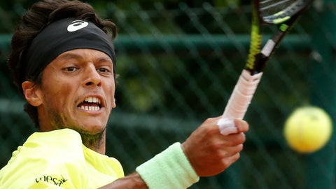 <p>               FILE - In this Tuesday, May 26, 2015 file photo Brazil's Joao Souza returns in the first round match of the French Open tennis tournament against Spain's Daniel Gimeno-Traver at the Roland Garros stadium, in Paris, France. Souza has been provisionally suspended again amid a corruption investigation by the Tennis Integrity Unit. Souza had already been provisionally suspended on March 29, 2019 but was reinstated following a successful appeal on April 8. (AP Photo/Christophe Ena, File)             </p>