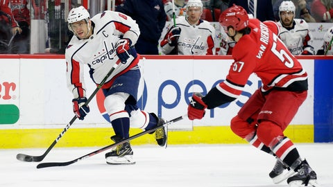 <p>               Washington Capitals' Alex Ovechkin (8), of Russia, takes a shot in goal as Carolina Hurricanes' Trevor van Riemsdyk (57) defends during the second period of an NHL hockey game in Raleigh, N.C., Thursday, March 28, 2019. (AP Photo/Gerry Broome)             </p>