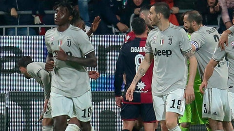 <p>               Cagliari fans shout to Juventus's Moise Kean, foreground left, after he scored his side's second goal during a Serie A soccer match between Cagliari and Juventus at the Sardegna Arena Stadium in Cagliari, Italy, Tuesday, April 2, 2019. Cagliari fans shouted racist chants at Kean after the 19-year-old scored in the 85th minute, the chants were so bad that Cagliari captain Luca Ceppitelli rushed in to protect the youngster and ask the fans to stop. (Fabio Murru/ANSA via AP)             </p>