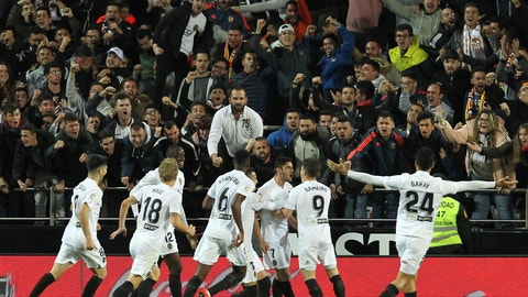 <p>               Valencia's Goncalo Guedes, center, celebrates with his teammate after scoring his opening goal during the Spanish La Liga soccer match between Valencia and Real Madrid at the Mestalla Stadium in Valencia, Spain, Wednesday, April 3, 2019. (AP Photo/Alberto Saiz)             </p>