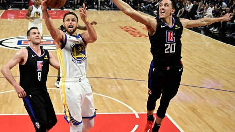 <p>               Golden State Warriors guard Stephen Curry, center, shoots as Los Angeles Clippers forward Danilo Gallinari, left, and guard Landry Shamet defend during the second half in Game 6 of a first-round NBA basketball playoff series Friday, April 26, 2019, in Los Angeles. The Warriors won 129-110. (AP Photo/Mark J. Terrill)             </p>