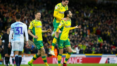 <p>               Norwich City's Mario Vrancic, right, celebrates scoring his side's second goal of the game during the English Championship soccer match at Carrow Road, Norwich, England, Saturday April 27, 2019. Norwich is returning to the Premier League after a three-year absence _ and Sheffield United is likely to be promoted, too. Norwich, a club from eastern England, clinched one of the two automatic promotion places from the second-tier League Championship by beating Blackburn 2-1 on Saturday.(Chris Radburn/PA via AP)             </p>