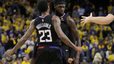 <p>               Los Angeles Clippers guard Lou Williams (23) celebrates with forward Montrezl Harrell during the second half of Game 2 of a first-round NBA basketball playoff series against the Golden State Warriors in Oakland, Calif., Monday, April 15, 2019. (AP Photo/Jeff Chiu)             </p>