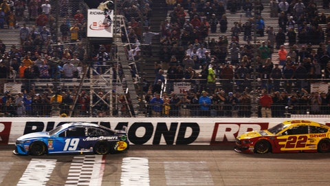 <p>               Martin Truex Jr. (19) crosses the finish line in front of Joey Logano (22) to win the NASCAR Cup Series auto race at Richmond Raceway in Richmond, Va., Saturday, April 13, 2019. (AP Photo/Steve Helber)             </p>