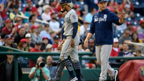 <p>               San Diego Padres shortstop Fernando Tatis Jr., front left, leaves a baseball game after being injured during the tenth inning of a baseball game against the Washington Nationals, Sunday, April 28, 2019, in Washington. (AP Photo/Nick Wass)             </p>