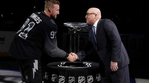 <p>               NHL Deputy Commissioner Bill Daly, right, shakes hands with Tampa Bay Lightning's Steven Stamkos (91) after presenting the team with the President's Trophy before an NHL hockey game Saturday, March 30, 2019, in Tampa, Fla. (AP Photo/Chris O'Meara)             </p>