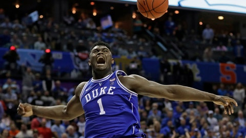 <p>               FILE - In this March 15, 2019, file photo, Duke's Zion Williamson (1) reacts after a dunk against North Carolina during the second half of an NCAA college basketball game in the Atlantic Coast Conference tournament, in Charlotte, N.C. Williamson was selected to The Associated Press All-America first team, Tuesday, April 2, 2019. (AP Photo/Nell Redmond, File)             </p>
