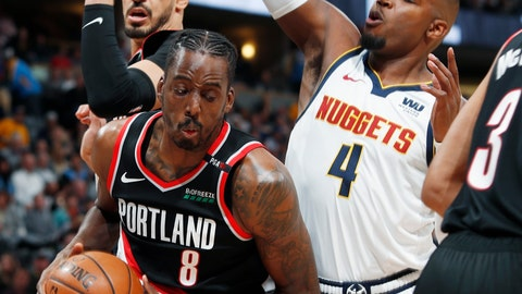 <p>               Portland Trail Blazers forward Al-Farouq Aminu, front left, pulls down a rebound in front of Blazers center Enes Kanter, back left, and Denver Nuggets forward Paul Millsap in the first half of Game 1 of an NBA basketball second-round playoff series Monday, April 29, 2019, in Denver. (AP Photo/David Zalubowski)             </p>