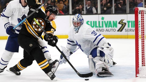 <p>               Boston Bruins left wing Brad Marchand, left, tries unsuccessfully to shoot past Toronto Maple Leafs goaltender Frederik Andersen (31) during the second period of Game 7 of an NHL hockey first-round playoff series, Tuesday, April 23, 2019, in Boston. (AP Photo/Charles Krupa)             </p>