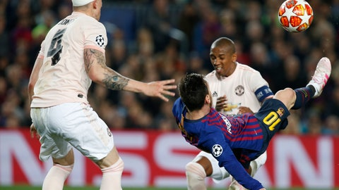 <p>               Barcelona forward Lionel Messi tries to score with a bicycle kick during the Champions League quarterfinal, second leg, soccer match between FC Barcelona and Manchester United at the Camp Nou stadium in Barcelona, Spain, Tuesday, April 16, 2019. (AP Photo/Joan Monfort)             </p>