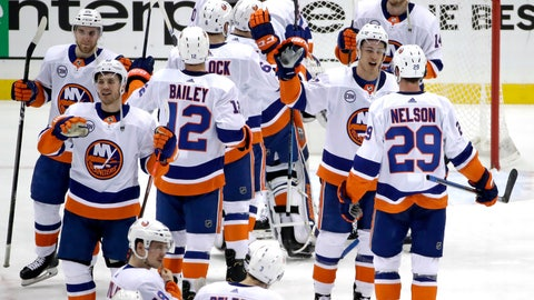 <p>               The New York Islanders celebrate at the end of Game 4 of an NHL hockey first-round playoff series against the Pittsburgh Penguins in Pittsburgh, Tuesday, April 16, 2019. The Islanders won 3-1, and swept the series. (AP Photo/Gene J. Puskar)             </p>