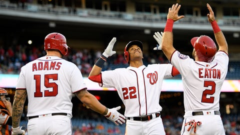 <p>               Washington Nationals' Juan Soto celebrates his two-run home run with Adam Eaton (2) and Matt Adams (15) during the first inning of the team's baseball game against the San Francisco Giants, Wednesday, April 17, 2019, in Washington. (AP Photo/Nick Wass)             </p>