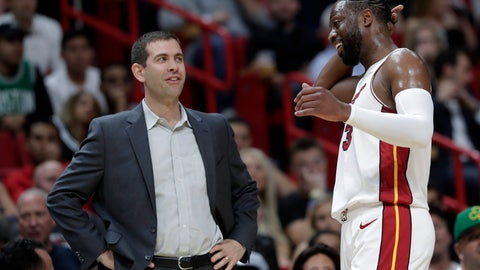 <p>               Boston Celtics coach Brad Stevens, left, talks with Miami Heat guard Dwyane Wade during the second half of an NBA basketball game Wednesday, April 3, 2019, in Miami. The Celtics won 112-102. (AP Photo/Lynne Sladky)             </p>