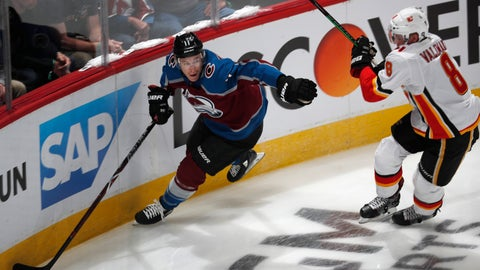 <p>               Colorado Avalanche left wing Matt Calvert, left, picks up the puck along the boards with Calgary Flames defenseman Juuso Valimaki in pursuit during the first period of Game 4 of an NHL hockey playoff series Wednesday, April 17, 2019, in Denver. (AP Photo/David Zalubowski)             </p>