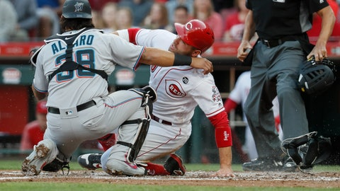 <p>               Miami Marlins catcher Jorge Alfaro (38) tags out Cincinnati Reds' Joey Votto, center, to complete a double play in the first inning of a baseball game, Wednesday, April 10, 2019, in Cincinnati. (AP Photo/John Minchillo)             </p>