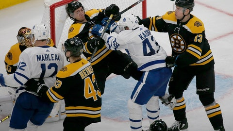 <p>               Boston Bruins defenseman Connor Clifton (75) and Toronto Maple Leafs center Nazem Kadri (43) shove each other at the goal during the third period of Game 2 of an NHL hockey first-round playoff series, Saturday, April 13, 2019, in Boston. (AP Photo/Mary Schwalm)             </p>