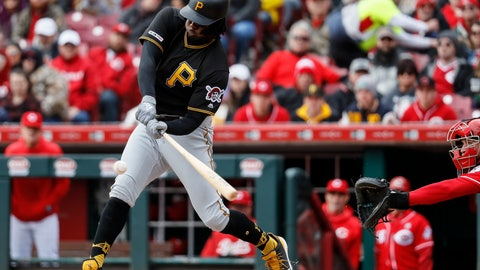 <p>               Pittsburgh Pirates first baseman Josh Bell hits an RBI-single off Cincinnati Reds starting pitcher Sonny Gray in the first inning of a baseball game, Sunday, March 31, 2019, in Cincinnati. (AP Photo/John Minchillo)             </p>