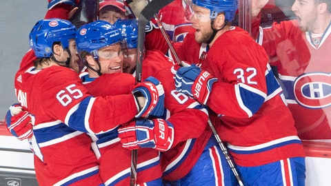 <p>               Montreal Canadiens center Max Domi, second left, celebrates with teammates after scoring the team's fourth goal against the Tampa Bay Lightning during the third period of an NHL hockey game, Tuesday, April 2, 2019 in Montreal. (Ryan Remiorz/The Canadian Press via AP)             </p>