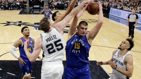 <p>               Denver Nuggets center Nikola Jokic (15) is defended by San Antonio Spurs center Jakob Poeltl (25) as he tries to score during the first half of Game 4 of an NBA basketball playoff series in San Antonio, Saturday, April 20, 2019. (AP Photo/Eric Gay)             </p>