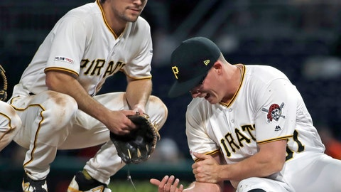<p>               Pittsburgh Pirates relief pitcher Nick Burdi, right, holds his arm after delivering a pitch during the eighth inning of a baseball game against the Arizona Diamondbacks in Pittsburgh, Monday, April 22, 2019. Burdi left the game with a team trainer, and the Diamondbacks won 12-4. (AP Photo/Gene J. Puskar)             </p>