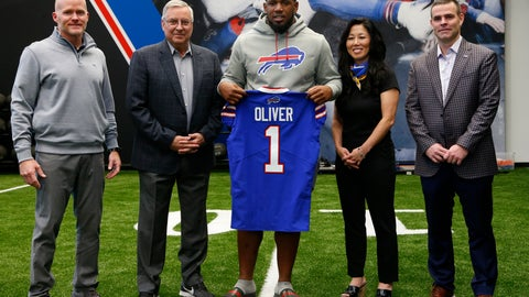 <p>               Buffalo Bills first-round draft pick Ed Oliver, center, poses with, from left to right, head coach Sean Mcdermott, owner Terry Pegula, owner/president Kim Pegula and general manager Brandon Beane pose for photographs following an NFL football news conference Friday, April 27, 2019, in Orchard Park N.Y. (AP Photo/Jeffrey T. Barnes)             </p>