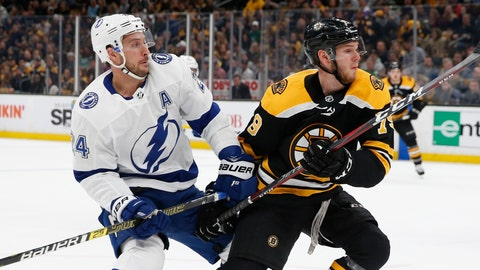 <p>               Boston Bruins' Jeremy Lauzon (79) defends against Tampa Bay Lightning's Ryan Callahan (24) during the first period of an NHL hockey game in Boston, Saturday, April 6, 2019. (AP Photo/Michael Dwyer)             </p>