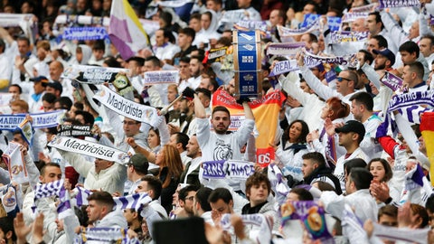 <p>               Real Madrid supporters celebrate after Karim Benzema scored their side's second goal during a Spanish La Liga soccer match between Real Madrid and Eibar at the Santiago Bernabeu stadium in Madrid, Spain, Saturday April 6, 2019. (AP Photo/Paul White)             </p>