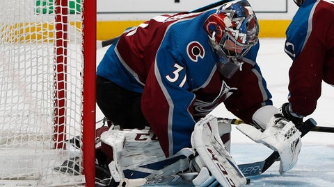 <p>               Colorado Avalanche goaltender Philipp Grubauer stops a shot against the Calgary Flames in the second period of Game 3 of a first-round NHL hockey playoff series, Monday, April 15, 2019, in Denver. (AP Photo/David Zalubowski)             </p>