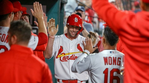 <p>               St. Louis Cardinals' Paul Goldschmidt is congratulated by teammates after hitting a solo home run during the fifth inning of the team's baseball game against the Los Angeles Dodgers on Tuesday, April 9, 2019, in St. Louis. (AP Photo/Scott Kane)             </p>