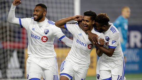 <p>               Montreal Impact's Anthony Jackson-Hamel (11) and Orji Okwonkwo (18) celebrate a goal by Shamit Shome (28) during the second half of an MLS soccer game against the New England Revolution, Wednesday, April 24, 2019, in Foxborough, Mass. (AP Photo/Stew Milne)             </p>