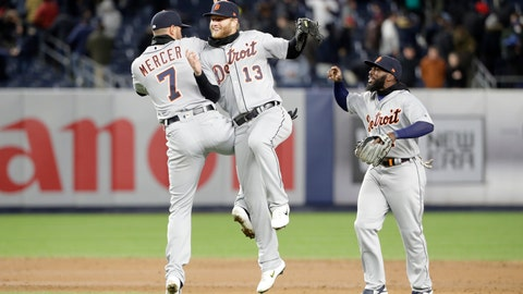 <p>               Detroit Tigers shortstop Jordy Mercer (7) and Tigers center fielder Dustin Peterson (13) celebrate by going airborne as Detroit Tigers second baseman Josh Harrison (1) joins them in celebrating after the Tigers defeated the New York Yankees 3-1 in a baseball game, Tuesday, April 2, 2019, in New York. (AP Photo/Kathy Willens)             </p>
