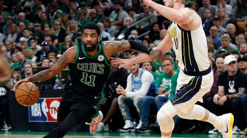 <p>               Boston Celtics' Kyrie Irving drives on Indiana Pacers' Domantas Sabonisn during the second quarter in Game 1 of a first-round NBA basketball playoff series, Sunday, April 14, 2019, in Boston. (AP Photo/Winslow Townson)             </p>