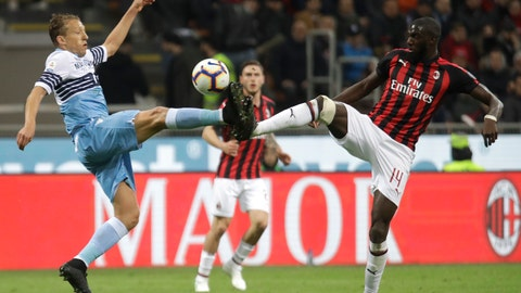 <p>               Lazio's Lucas Leiva, left, and AC Milan's Tiemoue Bakayoko challenge for the ball during the Serie A soccer match between AC Milan and Lazio, at the San Siro stadium in Milan, Italy, Saturday, April 13, 2019. (AP Photo/Luca Bruno)             </p>