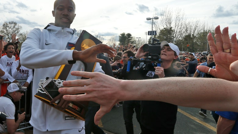 Huge crowd welcomes home national hoops champion Cavaliers