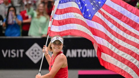 <p>               United States' Sofia Kenin carries the flag around the arena after winning a tie breaker against Switzerland's Timea Bacsinszky, after their playoff-round Fed Cup tennis match, Sunday, April 21, 2019, in San Antonio. (AP Photo/Darren Abate)             </p>